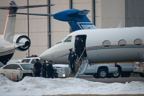 Image: Law enforcement officers leave a plane belonging to Justin Bieber that was detained in New Jersey