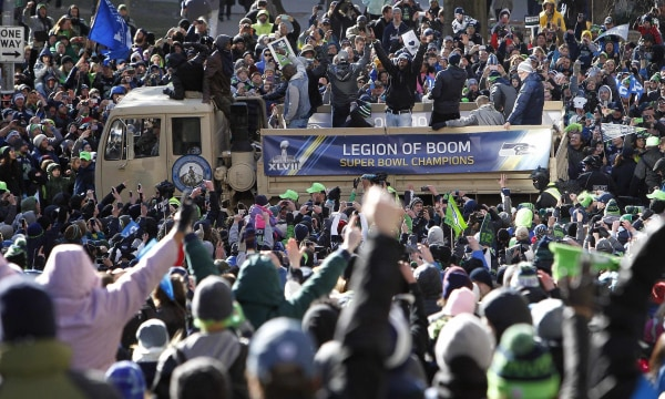 Image: Seahawks' Sherman celebrates with fans during the NFL team's Super Bowl victory parade in Seattle