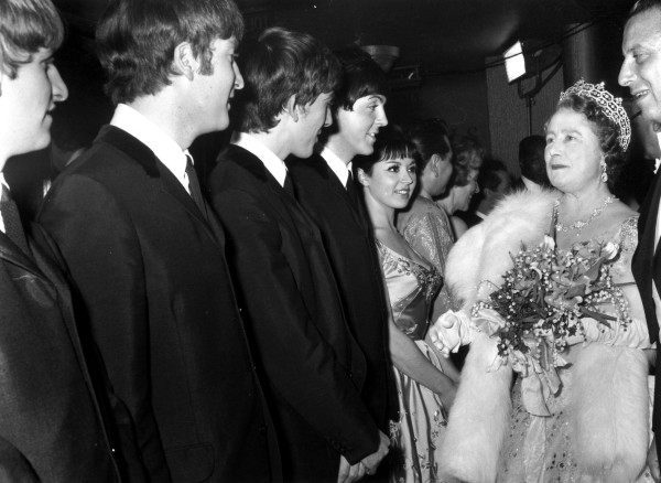 Image: Queen Elizabeth The Queen Mother (1900 - 2002) talking to British pop group The Beatles