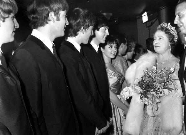 Image: Queen Elizabeth The Queen Mother (1900 - 2002) talking to British pop group The Beatles