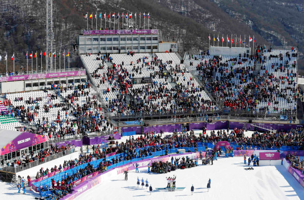 Image: Empty seats are seen in the spectator stands during the men's snowboard slopestyle final at the 2014 Sochi Olympic Games in Rosa Khutor