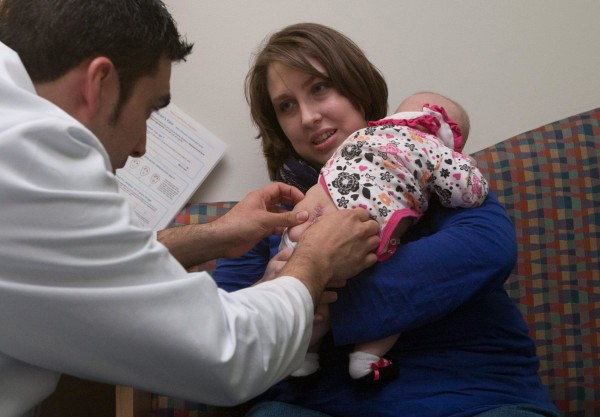 Image: Baby receives treatment for spina bifida