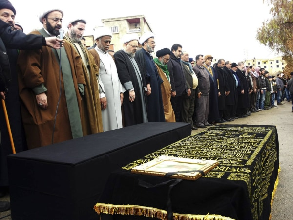 Image: Shiite Muslim sheiks and relatives of victims killed in a car bomb attack attend a funeral in Hermel, Lebanon, on Feb. 3