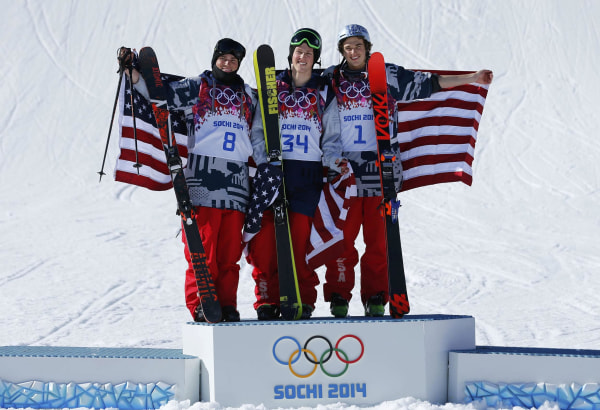 Image: U.S. finalists second placed Kenworthy, winner Christensen and third placed Goepper celebrate on podium after the men's freestyle skiing slopestyle finals at the 2014 Sochi Winter Olympic Games in Rosa Khutor