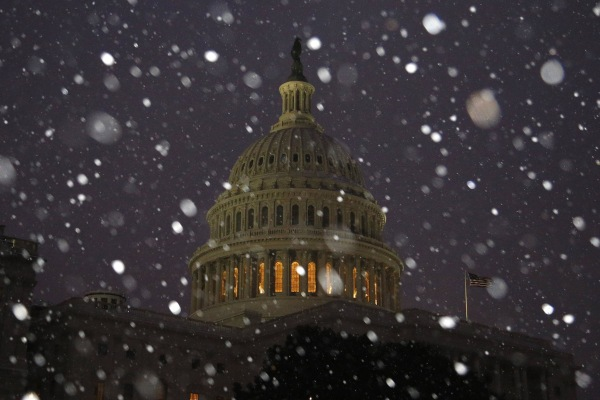 Image: A general view of the U.S. Capitol in early morning snow in Washington