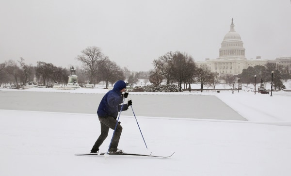 Image: A cross country skier braves the cold and snow near the U.S. Capitol Building on Thursday.