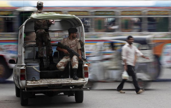Image: Rangers keep guard at an intersection in Karachi, Pakistan