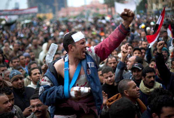 Image: Anti-Mubarak protesters shout slogans during a demonstration in Tahrir square in Cairo