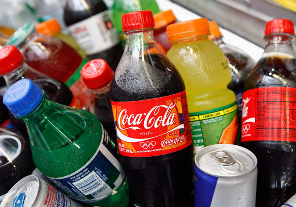 Image: A Coca-Cola bottle is seen with other beverages