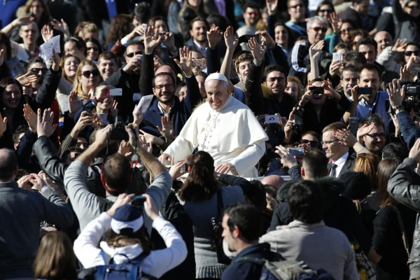Image: Pope Francis leaves at the end of a special audience with  engaged couple, to celebrate Saint Valentine's day, in Saint Peter