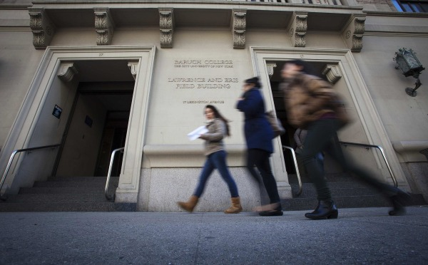 Image: People walk past Baruch College in New York
