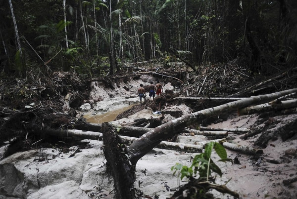 Image: Munduruku Indian warriors inspect a wildcat gold mine as they search for illegal gold mines and miners in western Para state