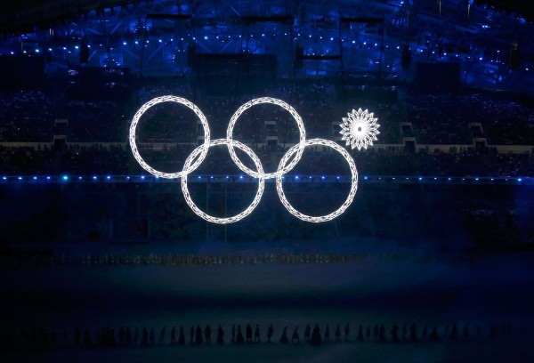 Image: Four of the five Olympic Rings are seen lit up at the start of the opening ceremony of the 2014 Sochi Winter Olympics