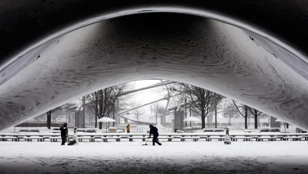 Image: A worker clears snow near Chicago's Cloud Gate sculpture on Jan. 2.