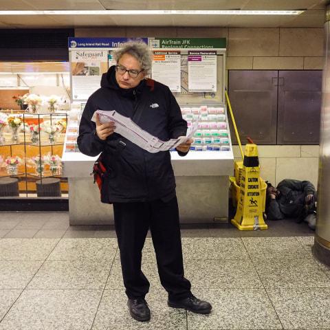 Image: A traveler in Penn Station
