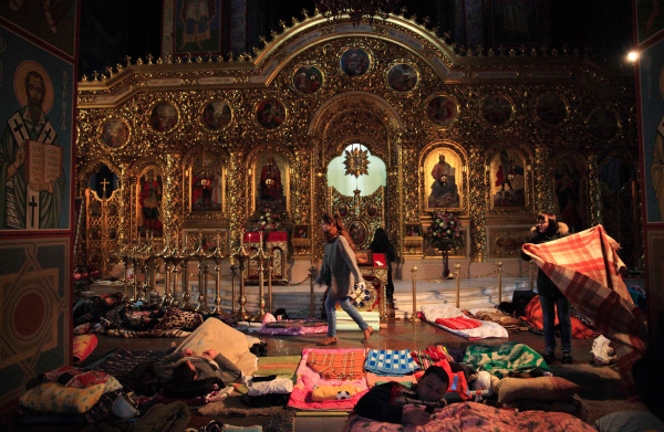 Image: People rest inside Mikhailovsky Zlatoverkhy Cathedral, which serves as a temporary shelter and a first-aid post for anti-government protesters, in Kiev