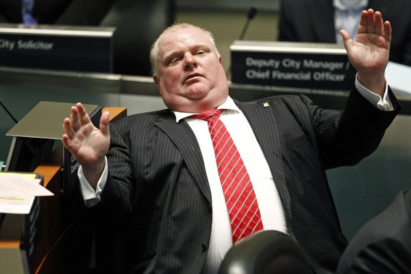 Image: Toronto Mayor Rob Ford reacts during a special council meeting at City Hall in Toronto