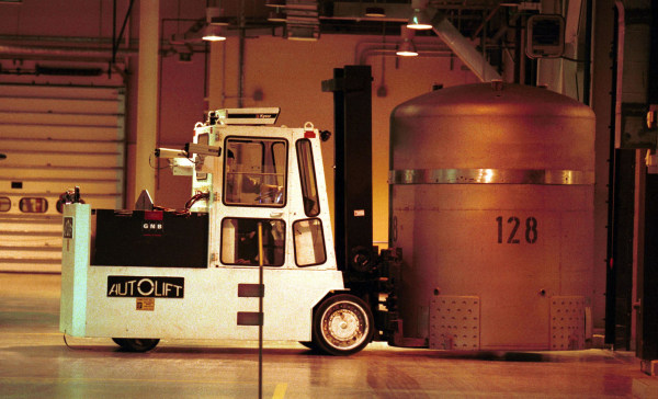 Image: A forklift is used to transfer a TRUPACT0-II from the trailer
