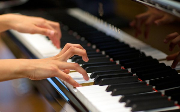 Image: Hands playing a piano