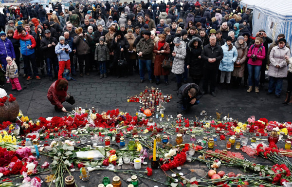 Image: Ukrainians praying for those who died during the anti-government demonstrations and clashes at the Independence Square in Kiev
