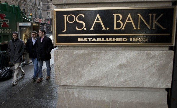 Sign for clothing retailer Jos. A. Bank in Manhattan. The Men's Wearhouse has increased its tender offer to acquire the clothing chain.