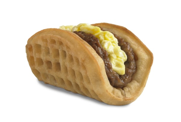 Taco Bell is starting breakfast service next month, with its new waffle taco taking aim at McDonald's Egg McMuffin.