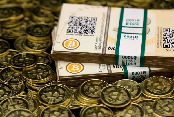 """Image: Some of Bitcoin enthusiast Mike Caldwell's coins and paper vouchers often called """"paper wallets"""" are pictured at his office in Sandy, Utah"""
