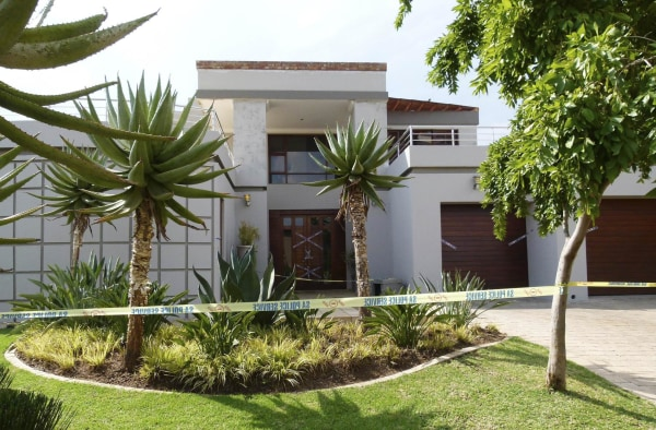 "Image: Police crime scene tape marks off the Pretoria home of South African ""Blade Runner"" Oscar Pistorius"
