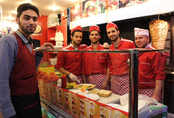 Image: Servers at the new Istanbul location of a Syrian fast food chain called Baloon, pose for a photo