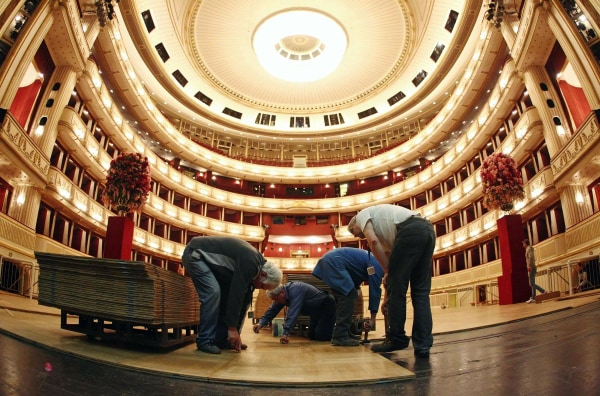Image: Workers lay the dance floor in the opera house in Vienna