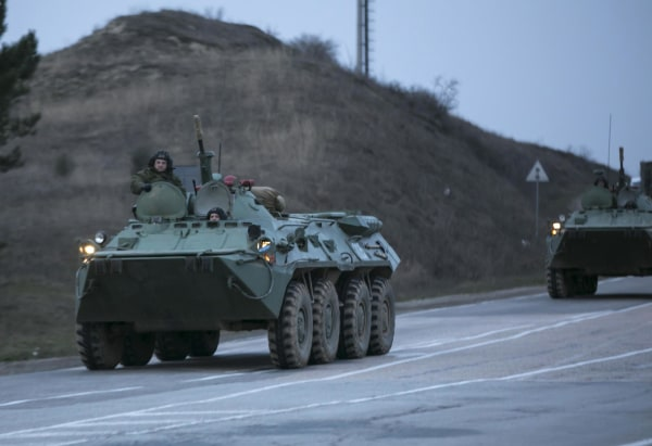 Image: Russian military armoured personnel carriers (APC) drive on the road from Sevastopol to Simferopol