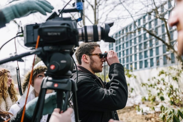 Image: High School student and director Max Novick frames a shot while shooting a scene in his upcoming film
