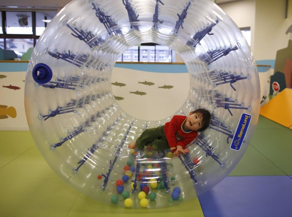 Image: Two-year-old Sakuya Zui plays at an indoor playground which was built for children and parents who refrain from playing outside because of concerns about nuclear radiation in Koriyama, west of the tsunami-crippled Fukushima Daiichi nuclear power pl