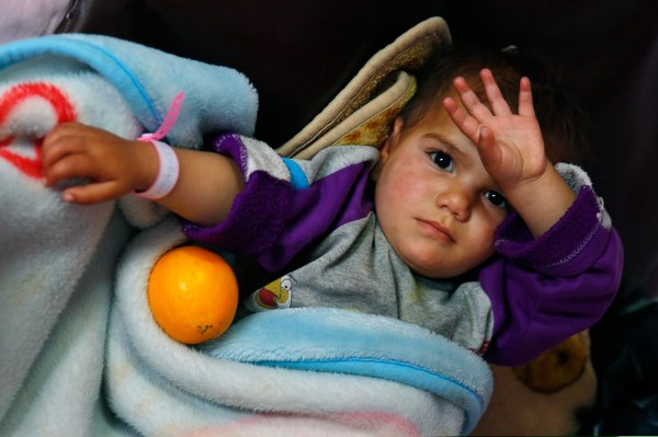 Image: Nevine Mohammed Almasre, 19 months, lays in her hospital bed in Chtaura's hospital in Chtaura, Lebanon, on March 11, 2014.