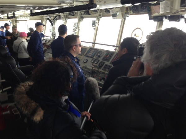 Image: John Yang interviews Lt. Cmdr. Anthony Maffia of the Coast Guard cutter Alder