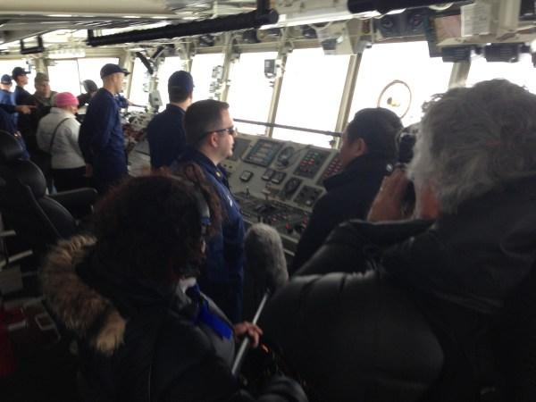 Image: John Yang interviews Lt. Cmdr. Anthony Maffia of the Coast Guard cutter Alder