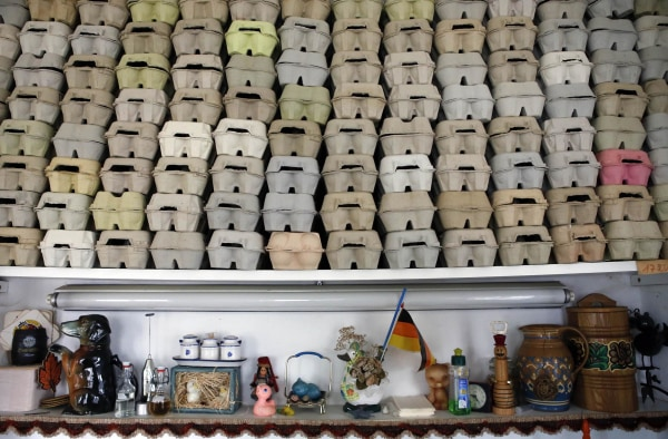 Image: Egg boxes are stacked in a room of German pensioners Christa and Volker Kraft's summerhouse in Saalfeld