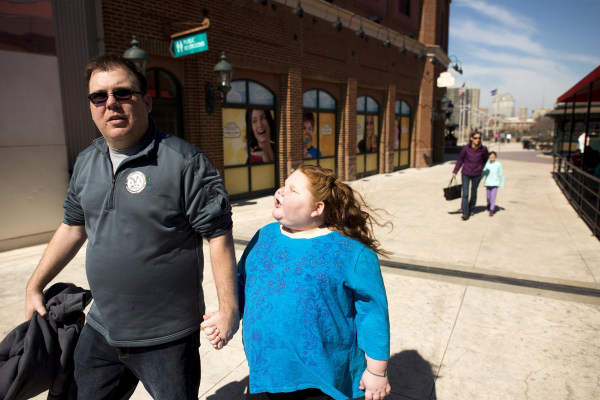 Image: Alexis Shapiro, 12, walks with her father Ian Shapiro