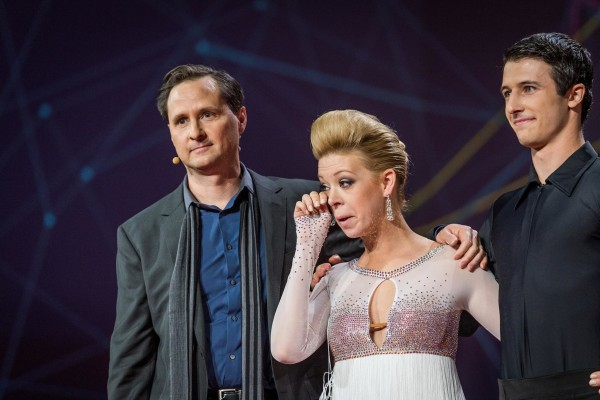 Image: Boston Marathon bombing survivor Adrianne Haslet-Davis, center, wipes a tear as she stands with Hugh Herr, director of the Biomechatronics group at The MIT Media Lab, left, and dancer Christian Lightner, right, during the international TED 2014 con