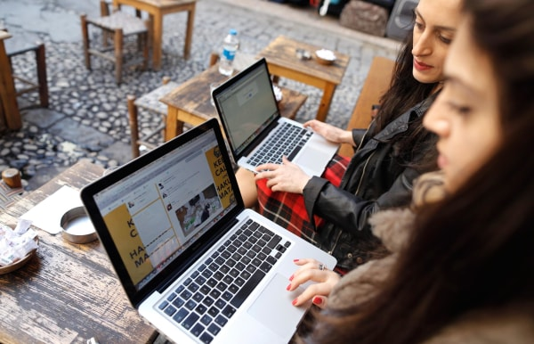Image: Two Turkish women try to connect to Twitter on their laptops at a cafe in Istanbul on Friday.