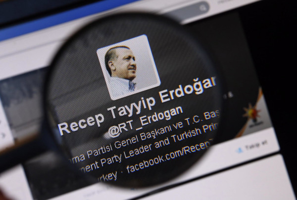 Image: An image of Turkish Prime Minister Erdogan on a twitter account is pictured through a magnifying glass in this illustration picture taken in Istanbul