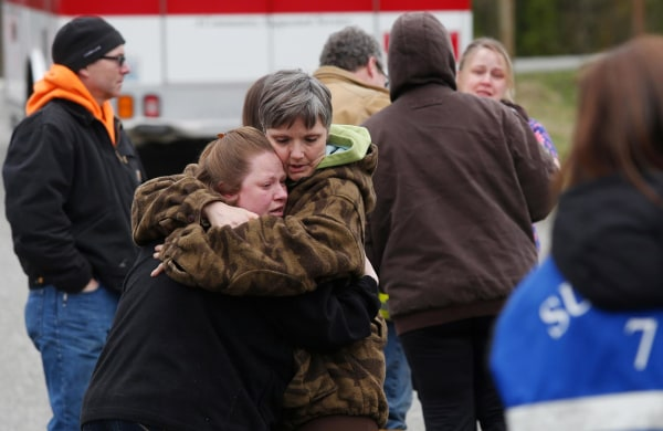 Image: Neighbors gather at the Oso Fire Department to wait for updates about the fatal mudslide that washed over homes and over Highway 530 east of Oso, Wash.