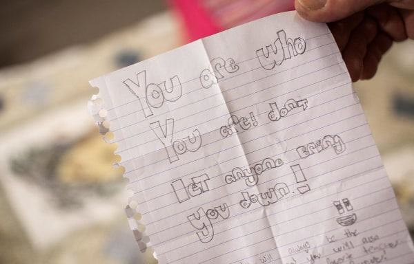 Image: Karen Scot shows a note from one of her students