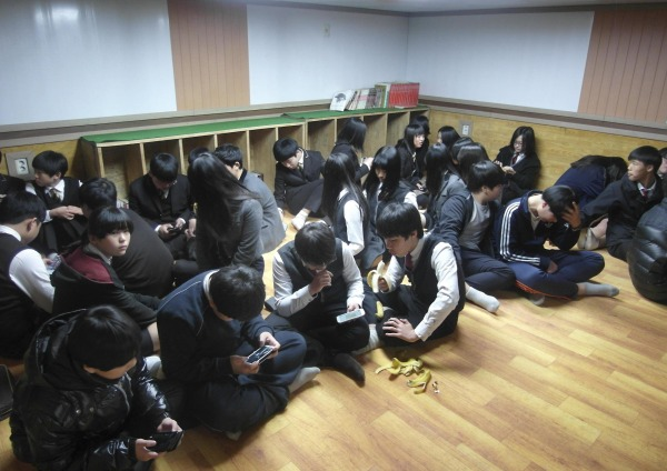 Image: South Korean students gather at a shelter on Yeonpyeong island, near the border with North Korea, on Monday.