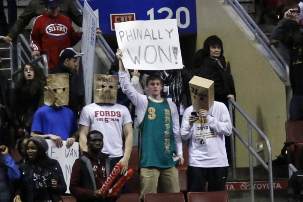 Image: Fans hold signs after the Philadelphia 76ers won an NBA basketball game against the Detroit Pistons