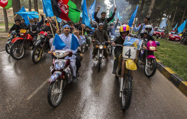 Image: Supporters of Afghan presidential candidate Abdullah Abdullah ride motorcycles, as they lead convoy after arrival to attend election campaign in Herat