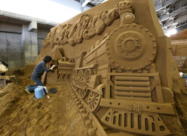 Image: Zhang Yan of China finishes a sand sculpture named 'Siberian Railway and Vladivostok as the Capital of far East' at the Sand Museum in Tottori, Japan