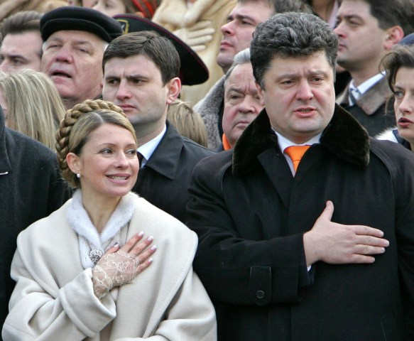 Image: Ukraine's leading candidates for prime minister, Yulia Tymoshenko and Petro Poroshenko