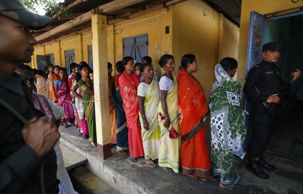 Image: Women wait to cast ballots in Agartala, India