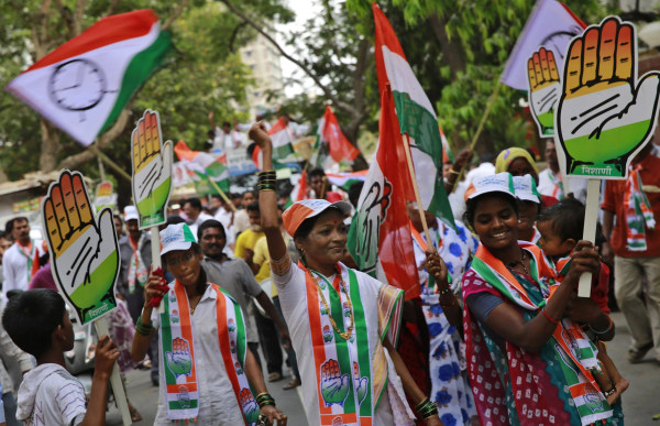 Image: Supporters of India's ruling Congress party dance at an election rally in Mumbai on Monday